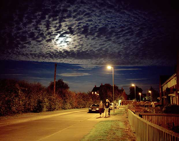 Image from British photographer Michal Solarski showing an almost empty street at night with some myterious looking clouds in the sky