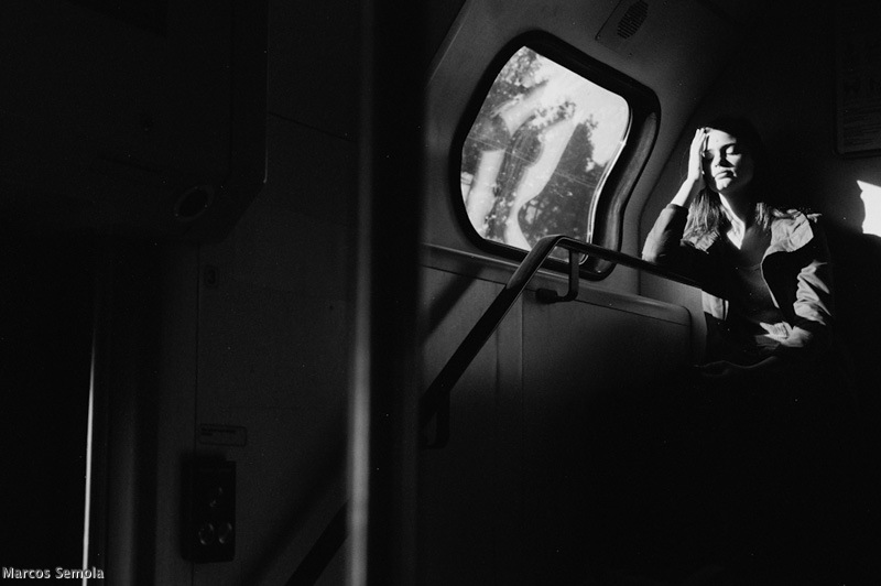 Street photographer Marcos Semola and his photo of a woman sleeping next to a window on a train