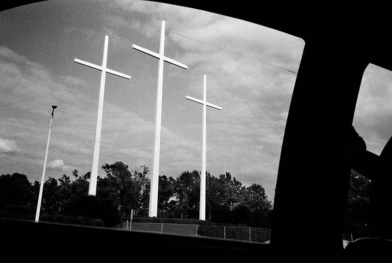 Image of religious crosses along the road by Jacob Perlmutter