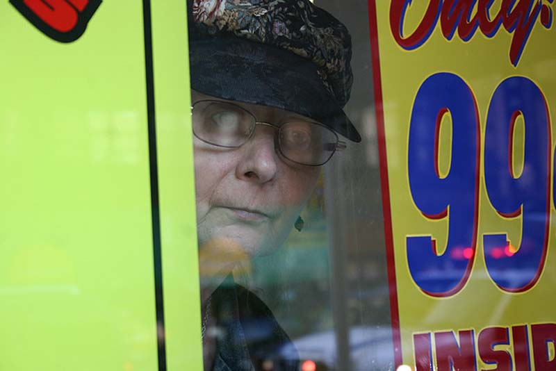 Woman behind a window caught by Steven Quinn