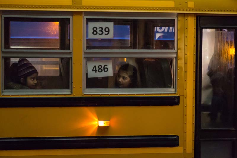 Two kids on a bus captured by street photographer Tom Young