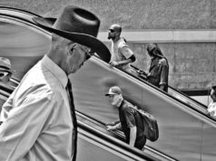 Man with a cowboy hat captured on a staircase by Alveraz Ricardez