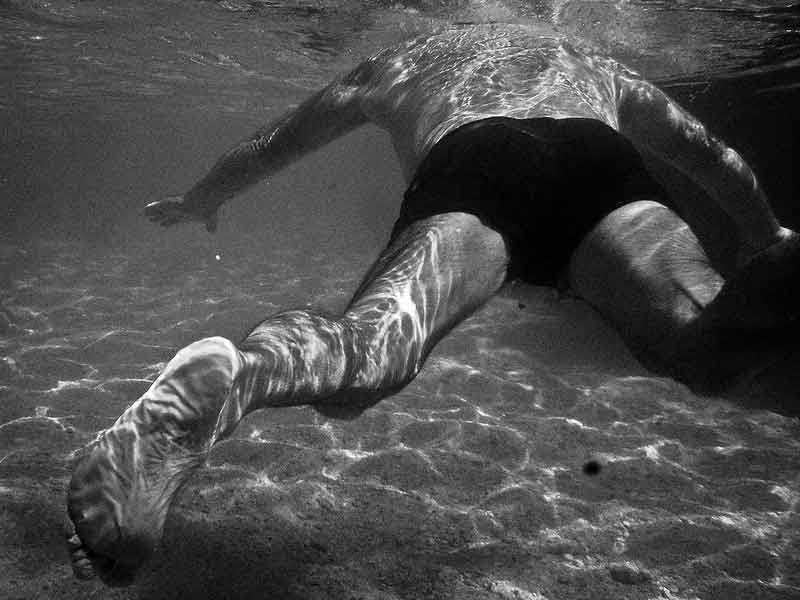 A man swimming under water captured by Italian street photographer Emilio Barillaro