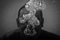 A man exhaling under water photographed by Emilio Barillaro