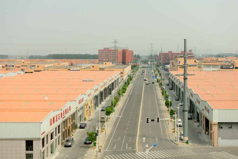 An image of a straight and empty street in China taken by Paul Batt