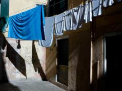 Laundry outside of a house drying in the sun captured by street photographer Anthony Spatara