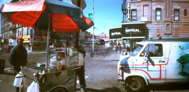 A man selling hot dogs on the street photographed by pinhole photographer Jeff McConnell