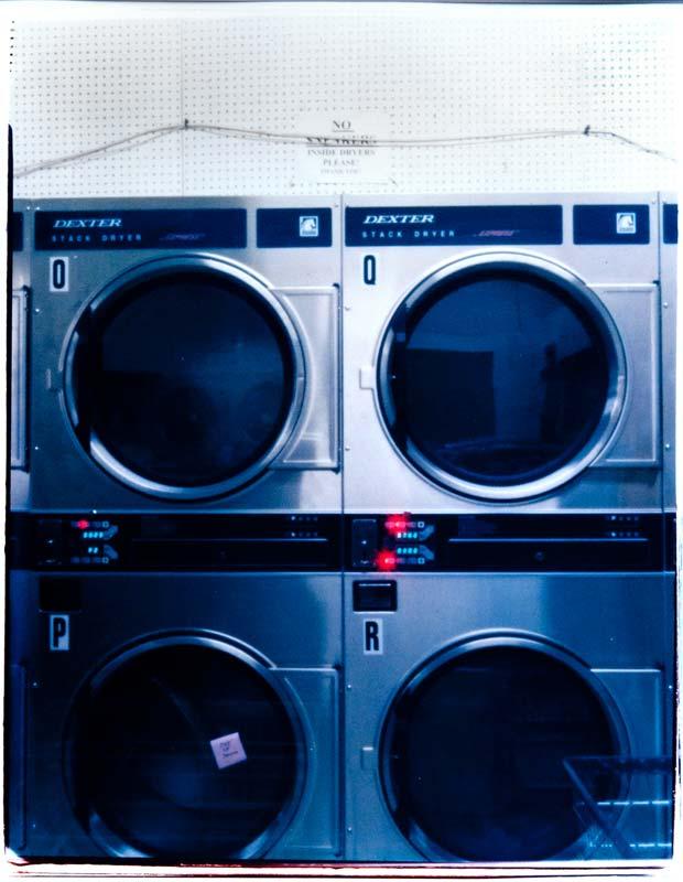 A pinhole photography image of a laundry machine taken by Christian Finbar Kelly