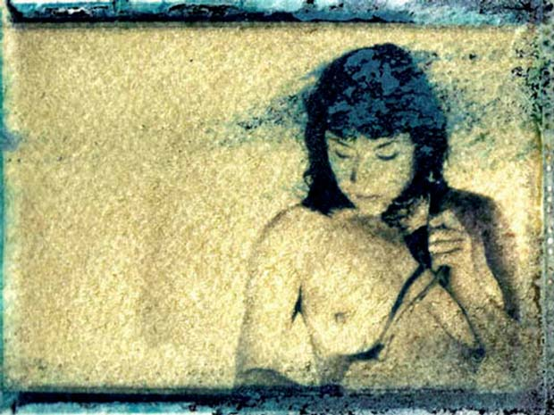 A half naked girl on an image from Christian Finbar Kelly processed with Polaroid transfer technique
