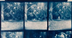 A pinhole photo of a ghostlike looking woman in a park taken by Christian Finbar Kelly