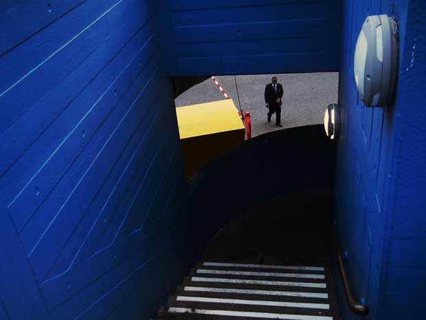 Street photography image from Dmitry Stepanenko showing a man standing at the end of a stairway