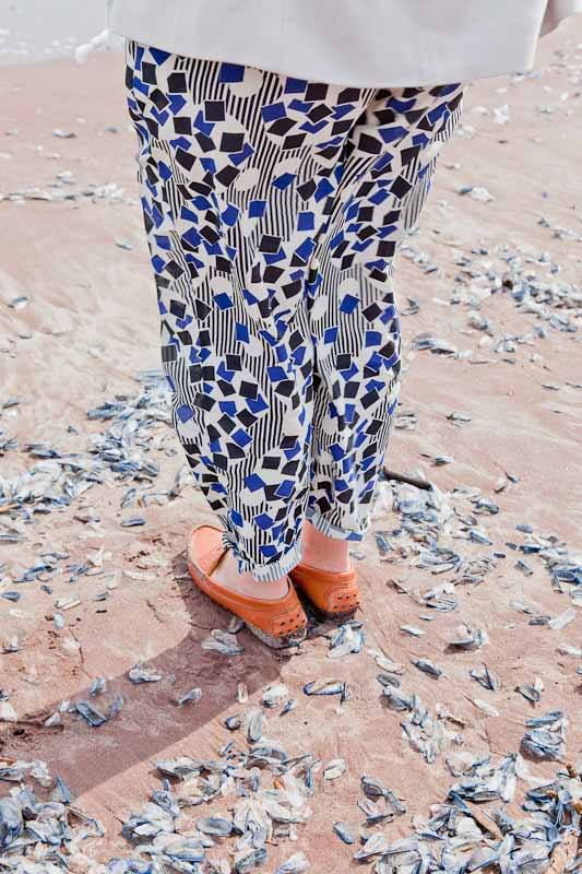 A woman wearing pants with a colorful pattern photographed by Fred Lahache
