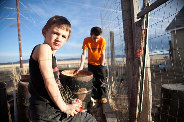 Two boys playing out in the countryside captured by photojournalist Greta Rybus