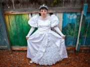 A girl dressed in a white wedding gown photographed by Greta Rybus