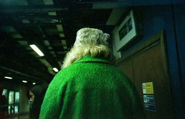 Image of a blond woman wearing a green coat taken by Marc Fairhurst