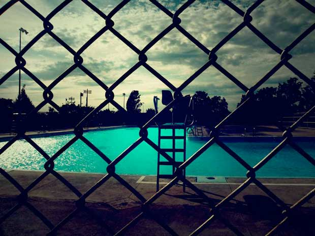 An image of a swimming pool with turquoise water photographed by Maria-Xenia Alnakidis