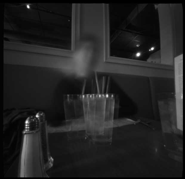 Pinhole image taken at a dinner table in a restaurant by Nancy Breslin