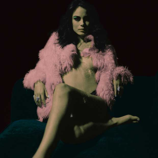A picture of a woman wearing a feather scarf taken by Neil Krug