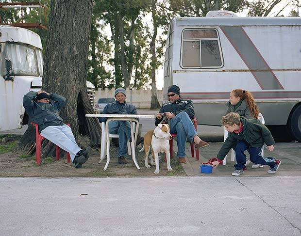 A group of people relaxing outside of their camper in Buenos Aires