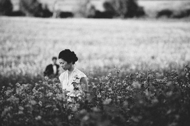 An Asian woman wandering around in a field photographed by Antonia Heil
