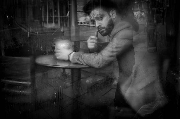 Image of a man sitting in a cafe taken by Darran Roper street photography