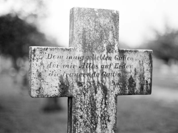 A cross on a graveyard photographed by Donny Tidmore