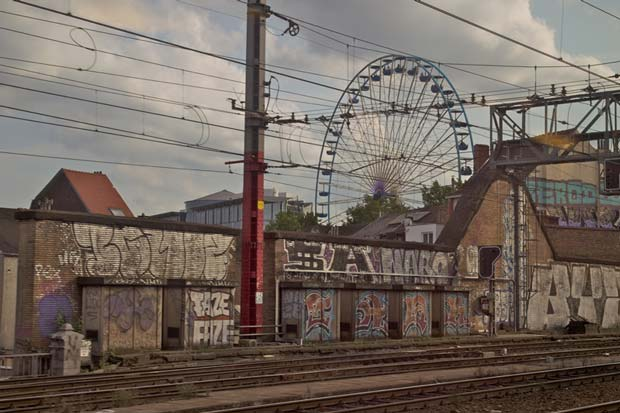 A giant wheel at a funfair can be seen from this railway station in Belgium Jarret Schechter