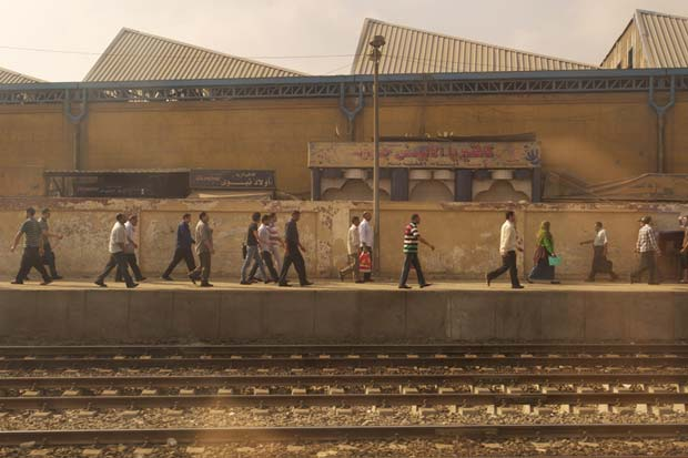 People walking on the other side of a platform at a railway station in Egypt captured by US photojournalist Jarret Schecter