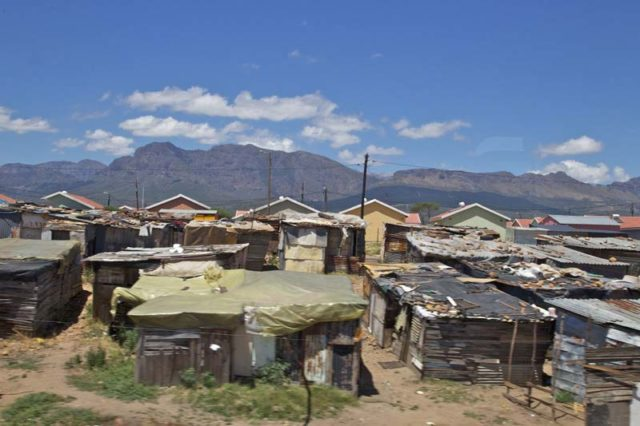 Image of a township taken from a train window in South Africa taken by Jarret Schecter