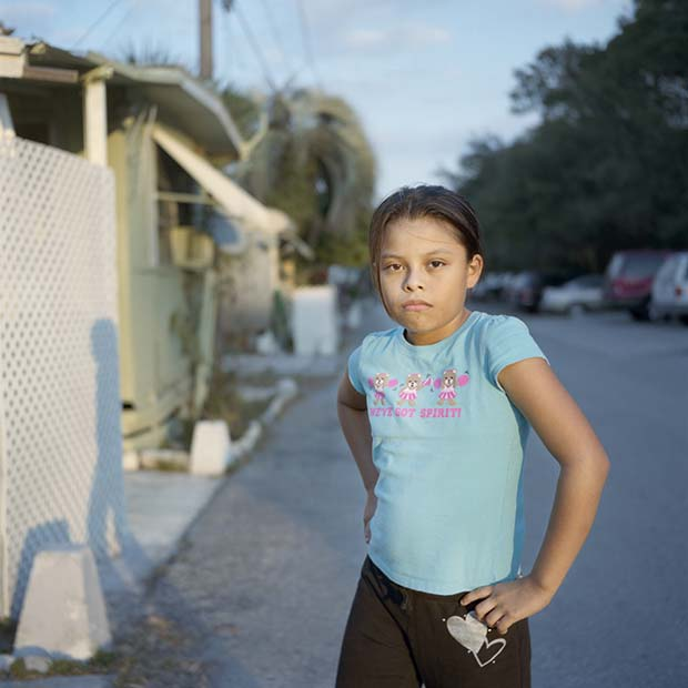 Portrait of a hispanic girl on a street taken by photographer Karen Aranago