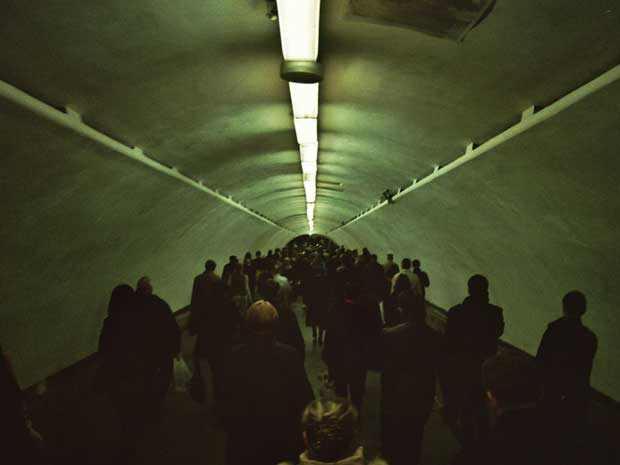 People walking through a tunnel photographed by Maarten van Riel