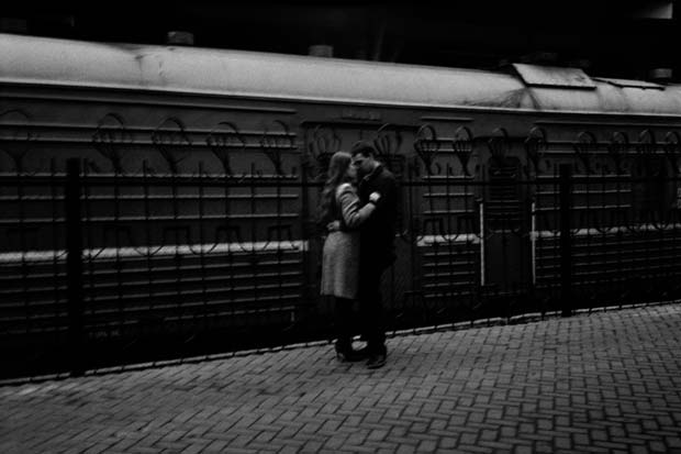 A couple kissing on the platform at a railway station can be witnessed on this photograph taken by Slovenian photographer Matjaz Rust photography