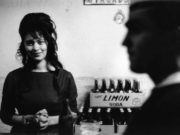 A woman in a bar in Valparaiso smiling on this image from Sergio Larrain