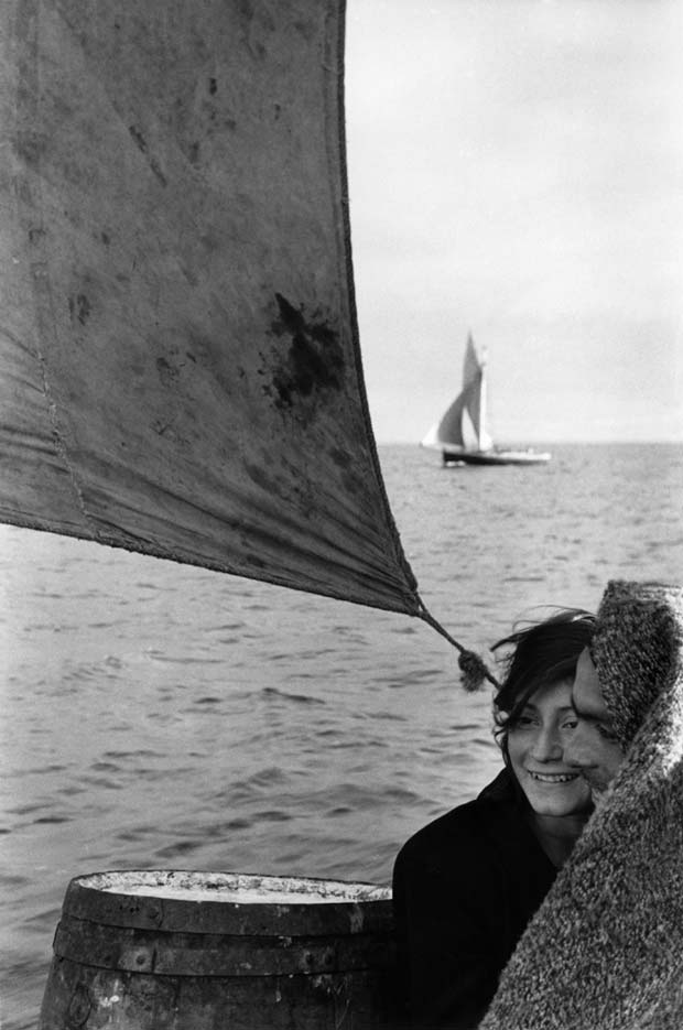 People on a sailing boat near the Chilean Island of Chiloe photographed by Sergio Larrain