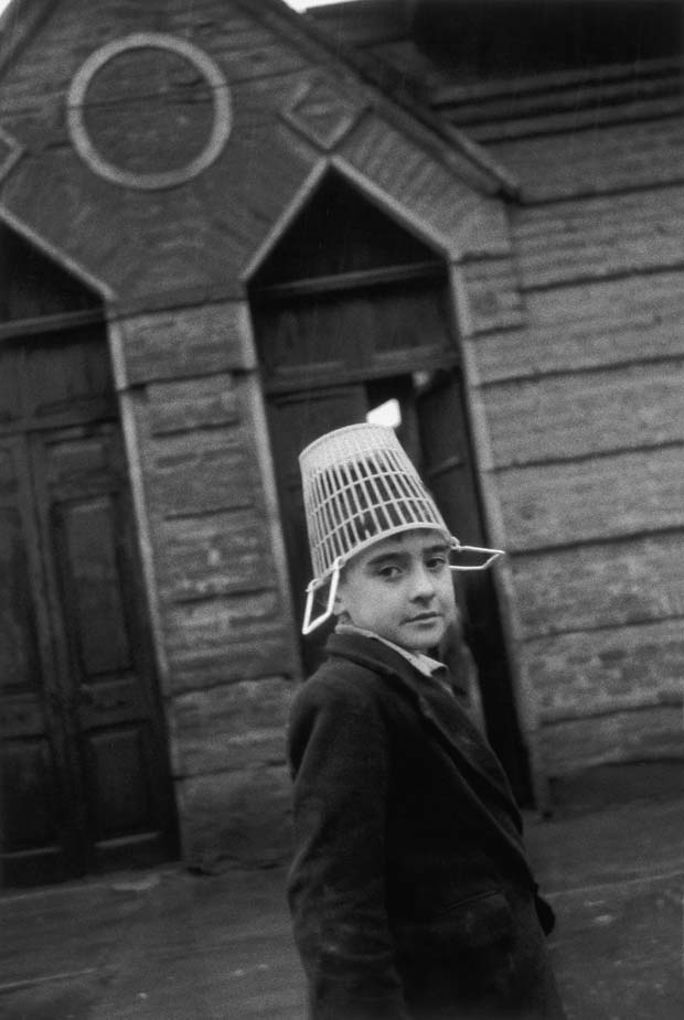 A portrait of a young boy wearing a hat captured by Sergio Larrain