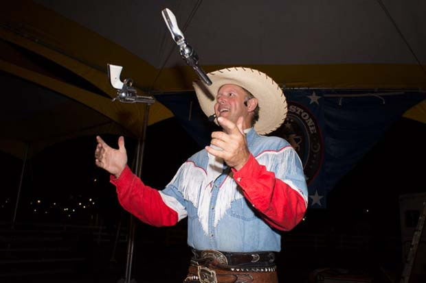 A cowboy juggling with two pistols photographed by Tammy Mercure