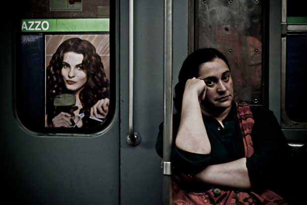 Image of a woman sitting in the subway taken by Luca Napoli street photography