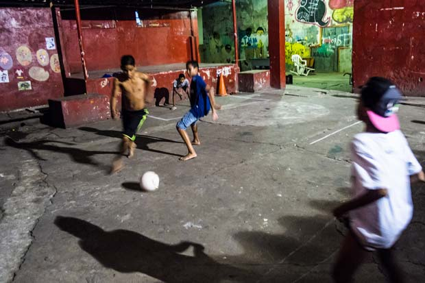 Kids playing football in a courtyard in Brazilian city of Sao Paulo