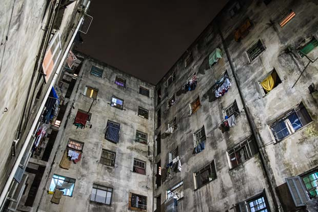 Laundry hanging out of the windows of an occupied apartment building in Sao Paulo, Brazil.