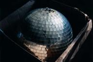 Image of a Disco Ball in a box taken by photographer Lisa Kereszi
