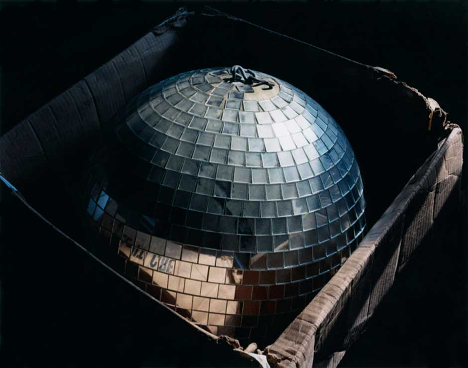Image of a Disco Ball in a box taken by photographer Lisa Kereszi