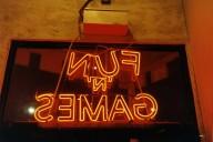 An image of a sign saying fun games taken by Lisa Kereszi