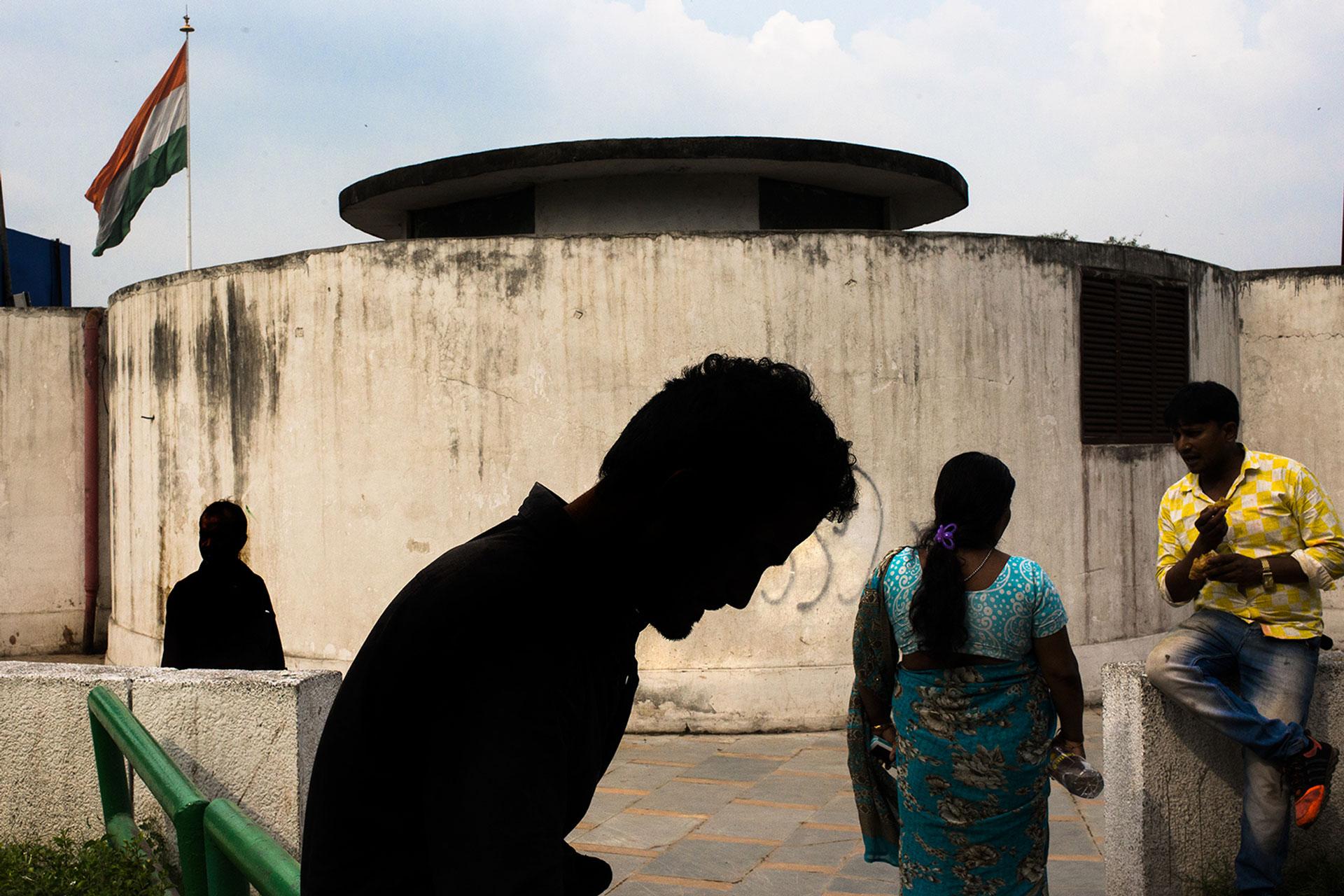 Street Photography in India by Pushkar Raj Sharma: Silhoutte of a man walking in the shadow