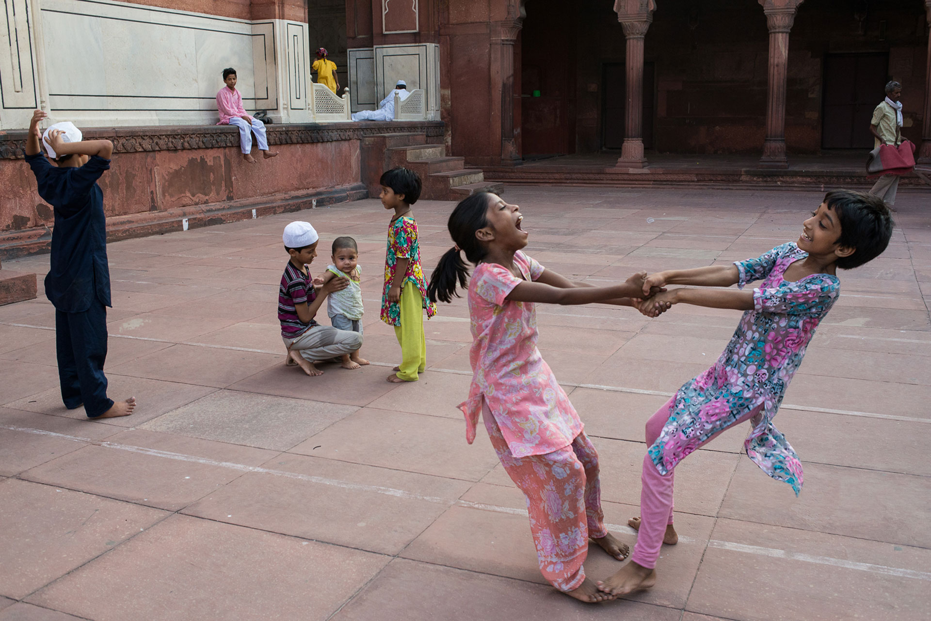Street Photography in India by Pushkar Raj Sharma: Two girls dancing happily